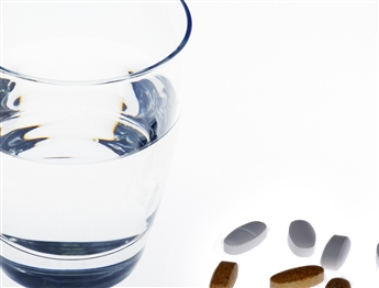 stockvault-pills-and-water135564.jpg